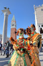 Two participants in venetian carnival. Royalty Free Stock Photos