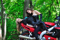 Two passionate girl on sports bike couple of girls in the forest a motorcycle Stock Images