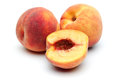 Two Peach and half peach Royalty Free Stock Photo