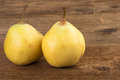 Two pears over wood Royalty Free Stock Photo