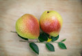 Two pears on wood ripe Stock Image
