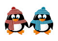 Two penguins wearing winter clothes Royalty Free Stock Photography