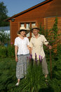 Two pensioners against a wooden house moscow region russia Stock Photography