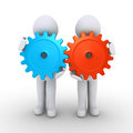 Two people with cogs as teamwork concept Royalty Free Stock Photo