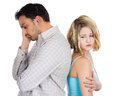 Two people couple woman and man back to back very sad disappointed with each other closeup portrait of women isolated on white Royalty Free Stock Image