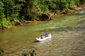 Two people drifting boat swift mountain river