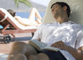 Two people relaxing in the sun Royalty Free Stock Photo