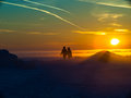 Two people are on the snow sunset background Royalty Free Stock Photos