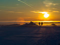 Two people watching the sunset on snow background Royalty Free Stock Images