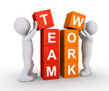 Two people work as team d are forming the word teamwork using cubes Stock Image