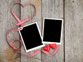 Two photo frames and small red candy heart Royalty Free Stock Photo