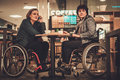 Two physically challenged women in a cafe Royalty Free Stock Photo