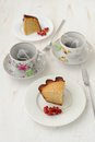 Two pieces of cake with two cups of tea Royalty Free Stock Photo