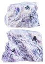 Two pieces of charoite crystalline rock isolated macro shooting natural mineral stone on white background Stock Photography