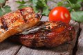 Two pieces of juicy meat grilled with rosemary Royalty Free Stock Photography