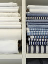 Two piles of cotton towels on shelf Stock Images
