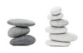 Two piles of sea stones black and white on white background Stock Image