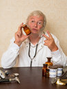 Two pills per day mature doctor telling the patien to take Stock Images