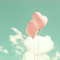 Two pink heart shaped balloons over blue sky Royalty Free Stock Photos