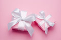 Two pink valentines day gift box tied white satin ribbon bow Royalty Free Stock Images