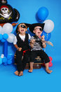 Two pirate on a blue background Royalty Free Stock Photo