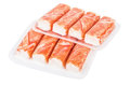 Two plastic packs with crab sticks isolated on white Royalty Free Stock Photo