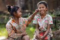 Two playful asian kids siem reap cambodia december little girl pinching the ear of her friend near the beng melea khmer temple Royalty Free Stock Image