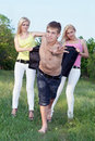 Two playful blonde and young man Royalty Free Stock Images