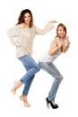 Two playful women wearing blue jeans and high heels isolated on white Royalty Free Stock Photo
