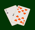 Two playing cards on green background Stock Photo