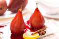Two poached pears in red wine with cinnamon Royalty Free Stock Photo