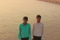 Two poor Indian boys on the banks of holy river Ganga Stock Photography