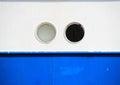 Two portholes on blue and white coaster background hull Royalty Free Stock Photo