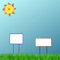 Two posters on a grass under the sun Stock Photography