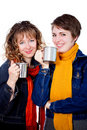 Two pretty girls having coffee Royalty Free Stock Images