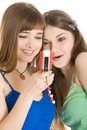 Two pretty girls reading SMS on mobile phone Royalty Free Stock Photo