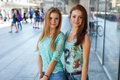 Two pretty girls. They're best friends. Outdoor photo. Royalty Free Stock Photo