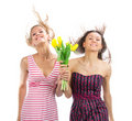 Two pretty happy girls with bouquet flowers Stock Image