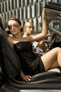 Two pretty woman in black car Royalty Free Stock Photos