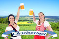 Two pretty women in dirndl with beer mug and banner Stock Images