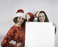 Two pretty women holding sign Royalty Free Stock Photography