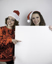 Two pretty women holding sign for copy space Royalty Free Stock Photo