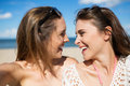 Two pretty women looking at each other laughing Royalty Free Stock Photo