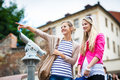 Two pretty, young women sightseeing in Prague Stock Photography
