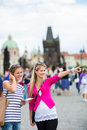 Two pretty, young women walking in the Prague Royalty Free Stock Images