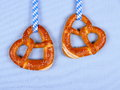Two pretzel in heart shape on blue background Royalty Free Stock Photo