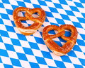 Two pretzel in heart shape on white blue background Royalty Free Stock Photo