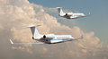 Two private jets flying side by side Royalty Free Stock Photo