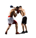 Two professionl boxers are fighting on the white isolated background Stock Photo