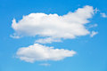 Two puffy white clouds in blue sky Royalty Free Stock Photo